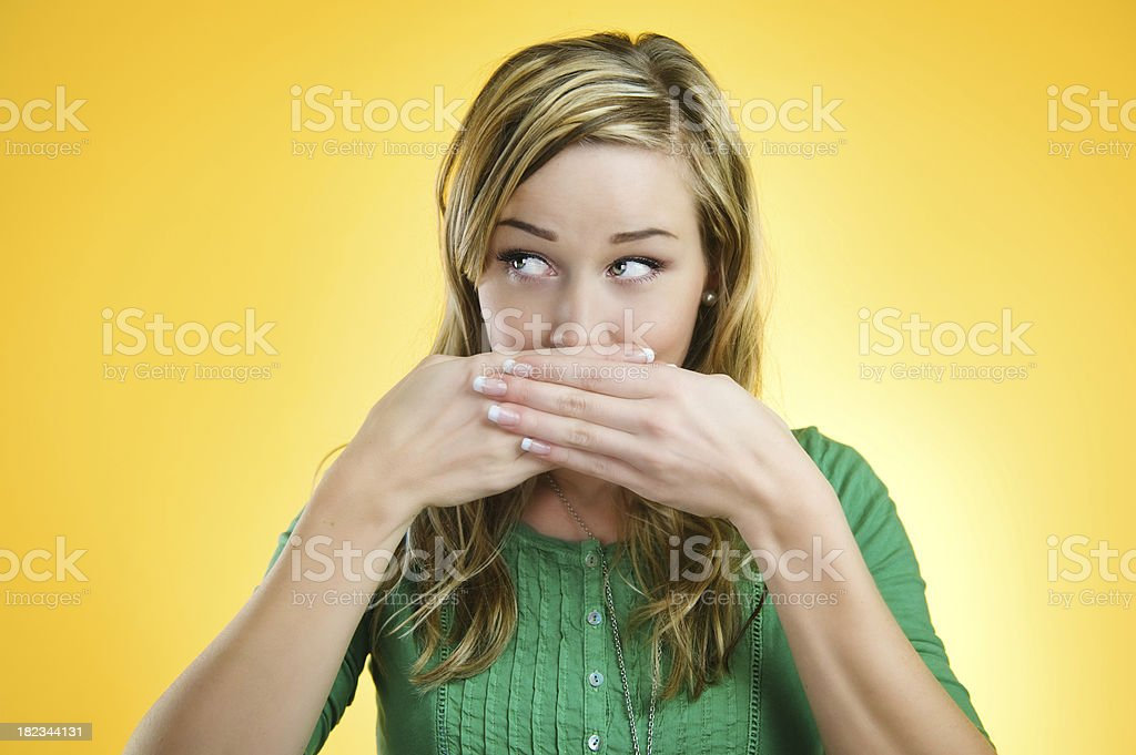 Yellow series - Hands over mouth royalty-free stock photo