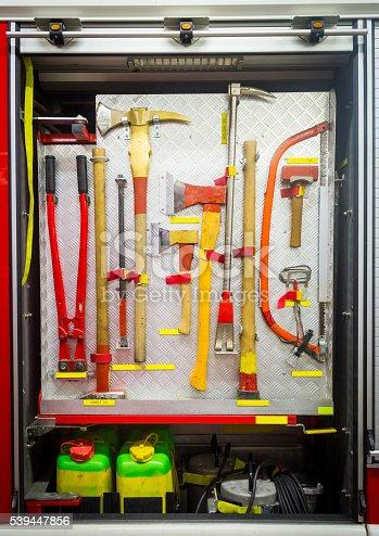 istock Yellow sharp firefighting tools in fire truck 539447856