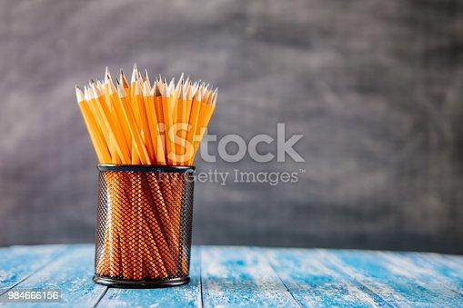 Yellow sharp pencil in black metal basket