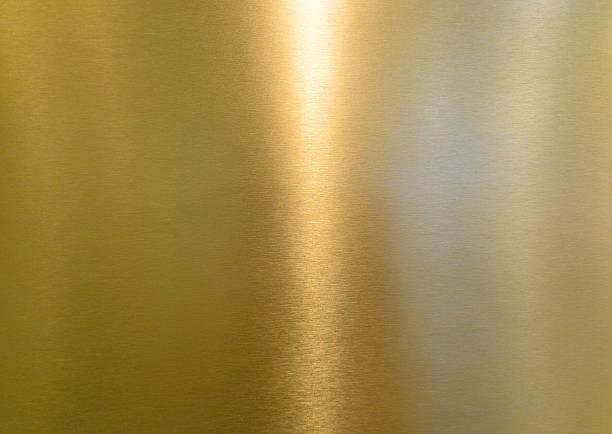 yellow shiny metal surface - messing stockfoto's en -beelden