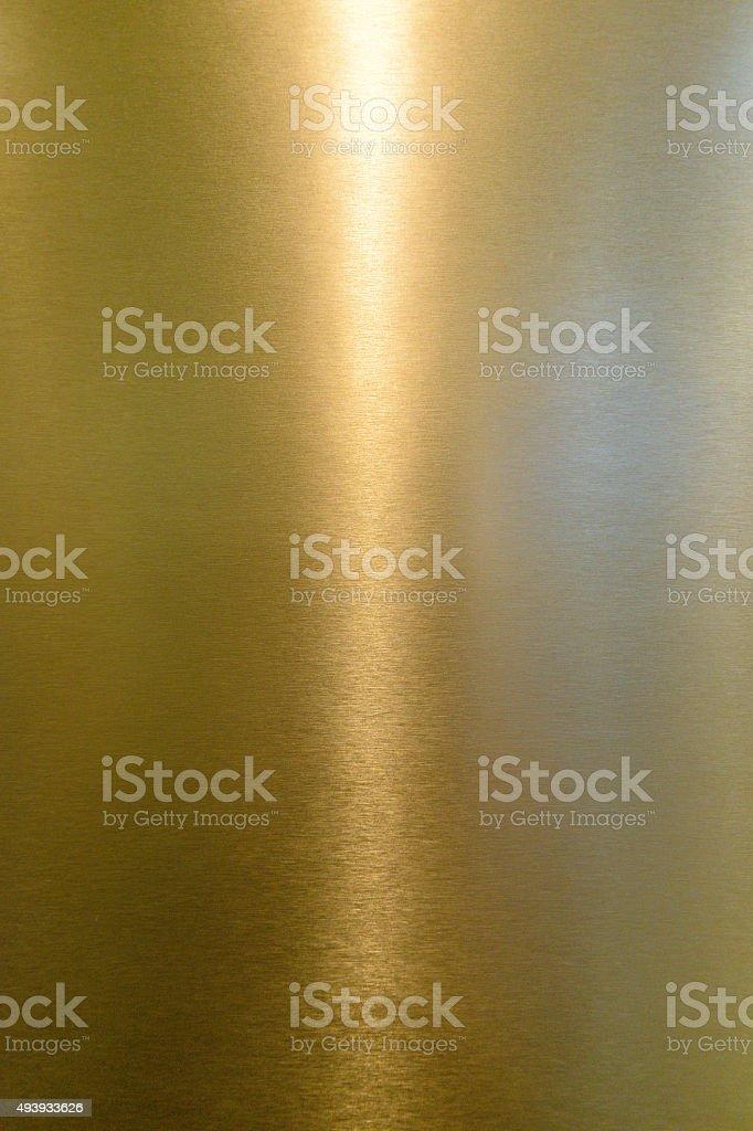 Yellow shiny metal surface stock photo