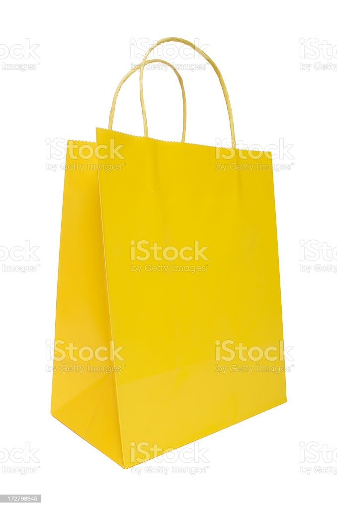 Yellow shopping bag isolated on a white background royalty-free stock photo