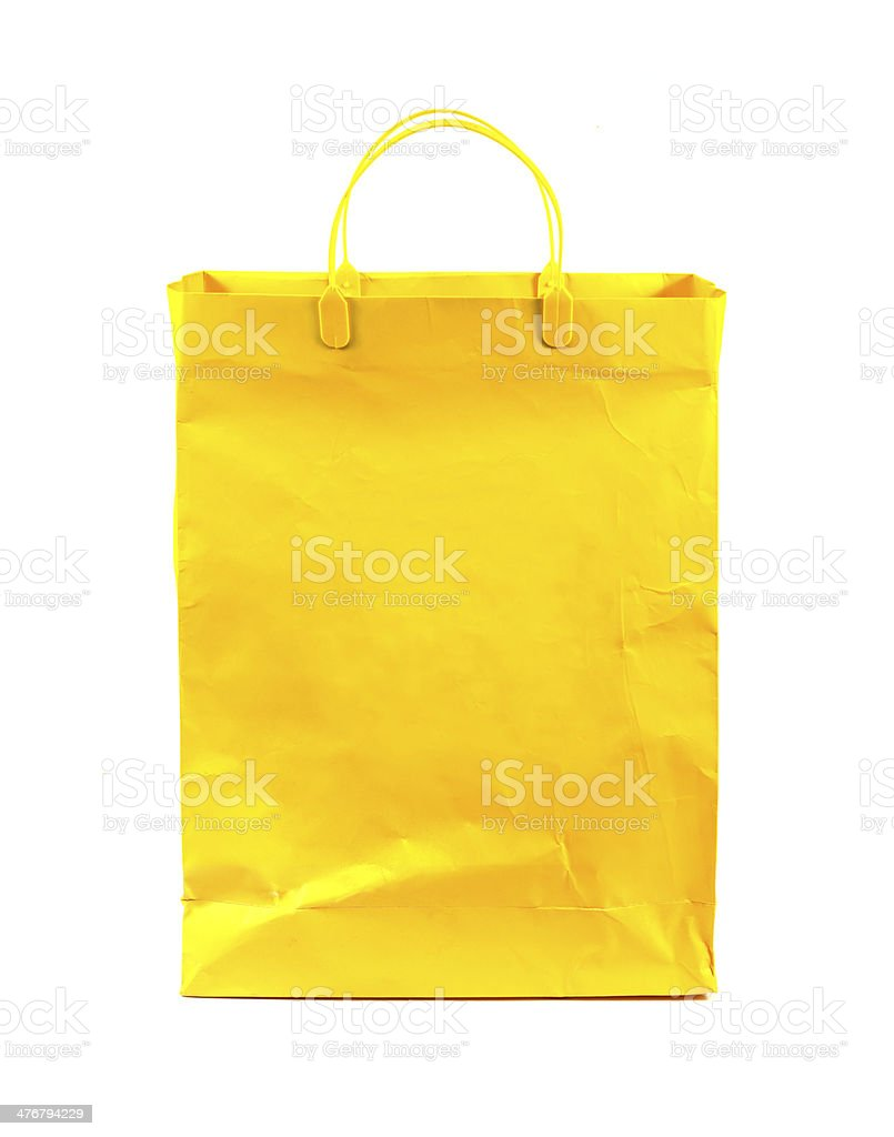 yellow shopping bag isolated on white background stock photo