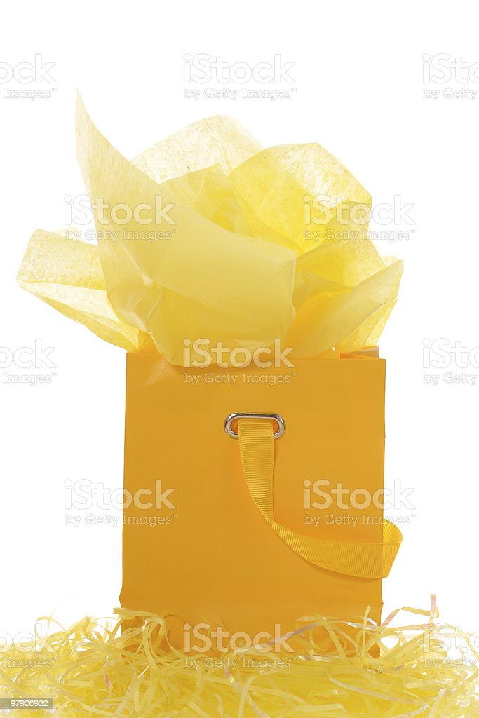 Yellow shopping bag on easter grass royalty-free stock photo