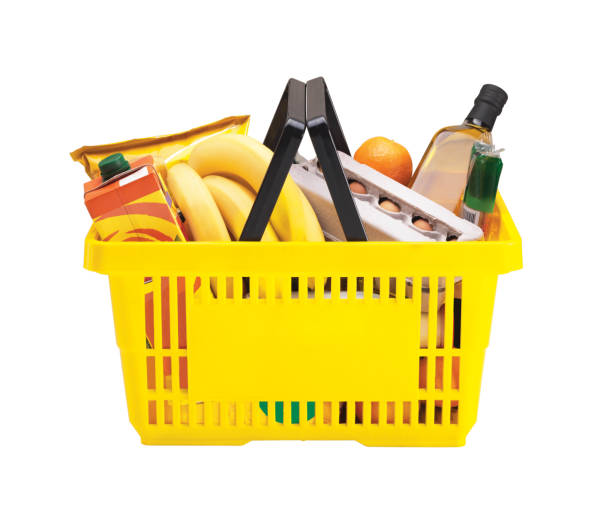 Yellow shopping basket filled with groceries  Shopping Basket With GroceriesPlease see some similar pictures from my portfolio: shopping basket stock pictures, royalty-free photos & images