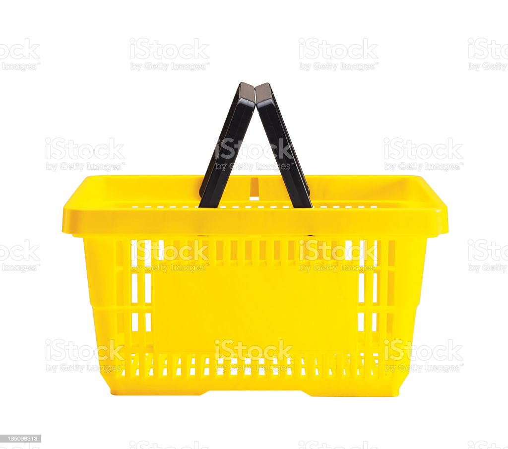 A yellow shopping basket with a black handle stock photo