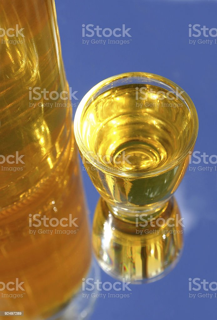 Yellow shot and bottle royalty-free stock photo