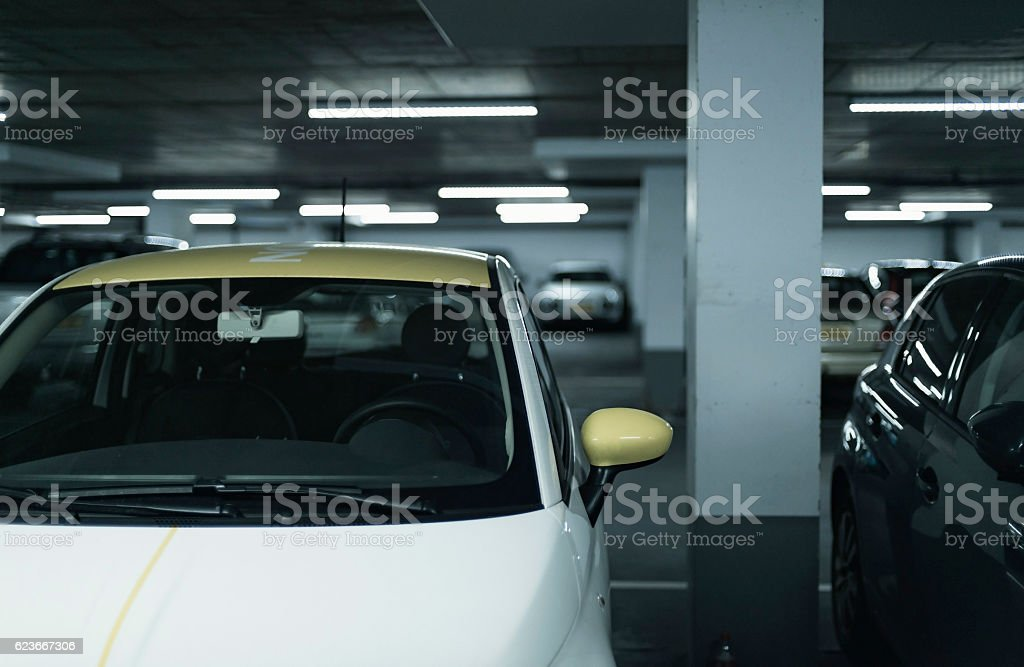 Yellow side mirror of car parked in garage. stock photo