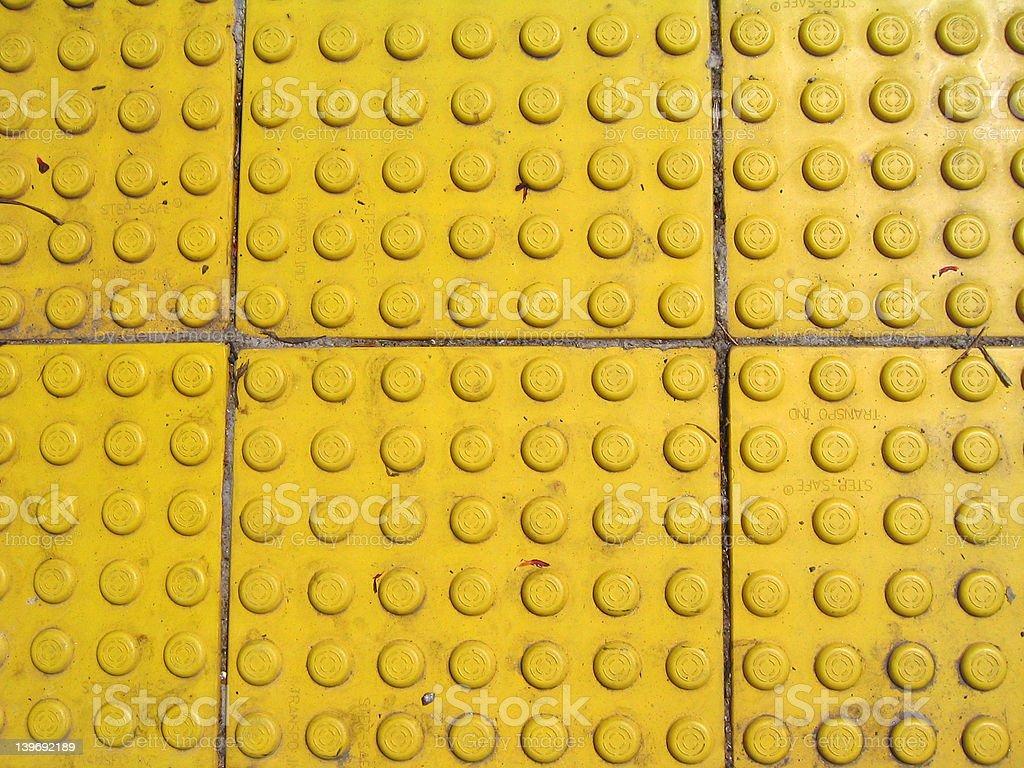 yellow sidewalk grippy thing royalty-free stock photo
