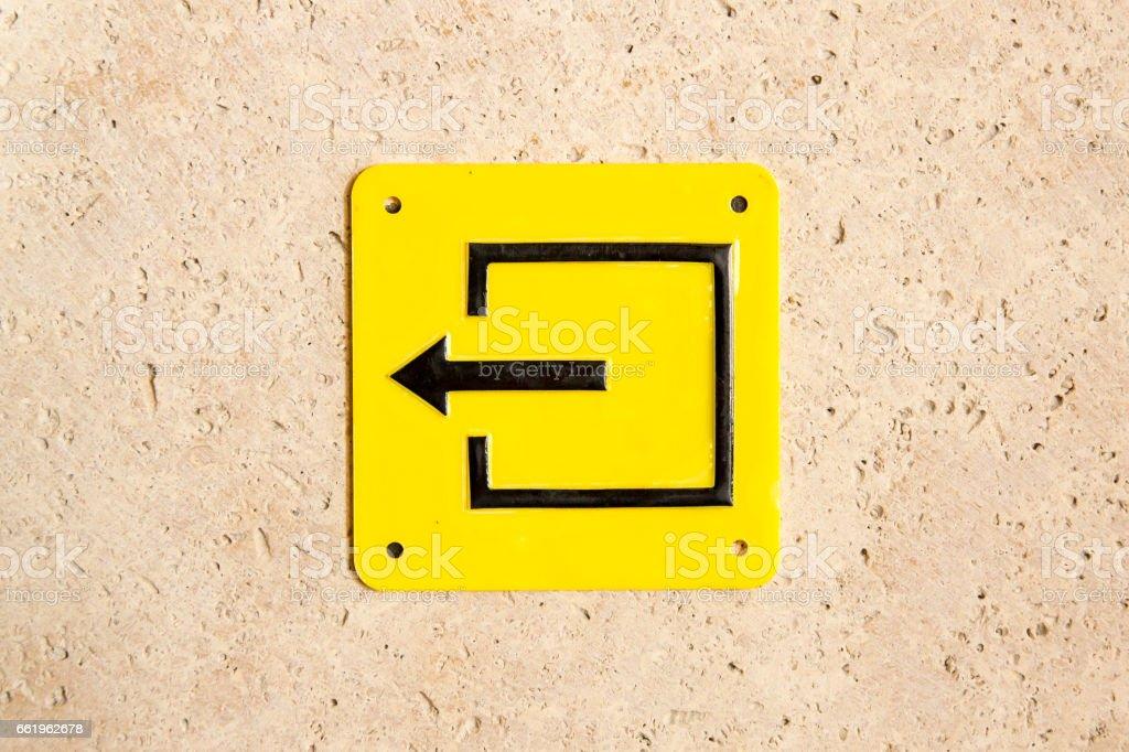 Yellow sign evacuation pointer arrow exit left stock photo