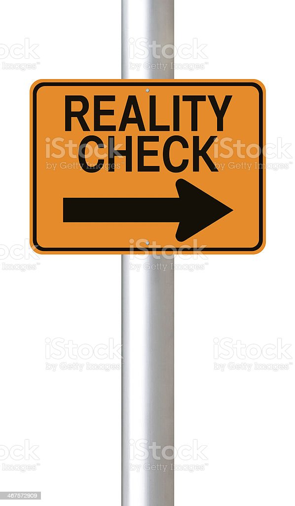 Yellow sign pointing right to Reality Check  stock photo