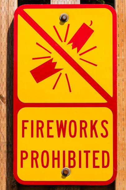 Yellow sign prohibiting fireworks stock photo