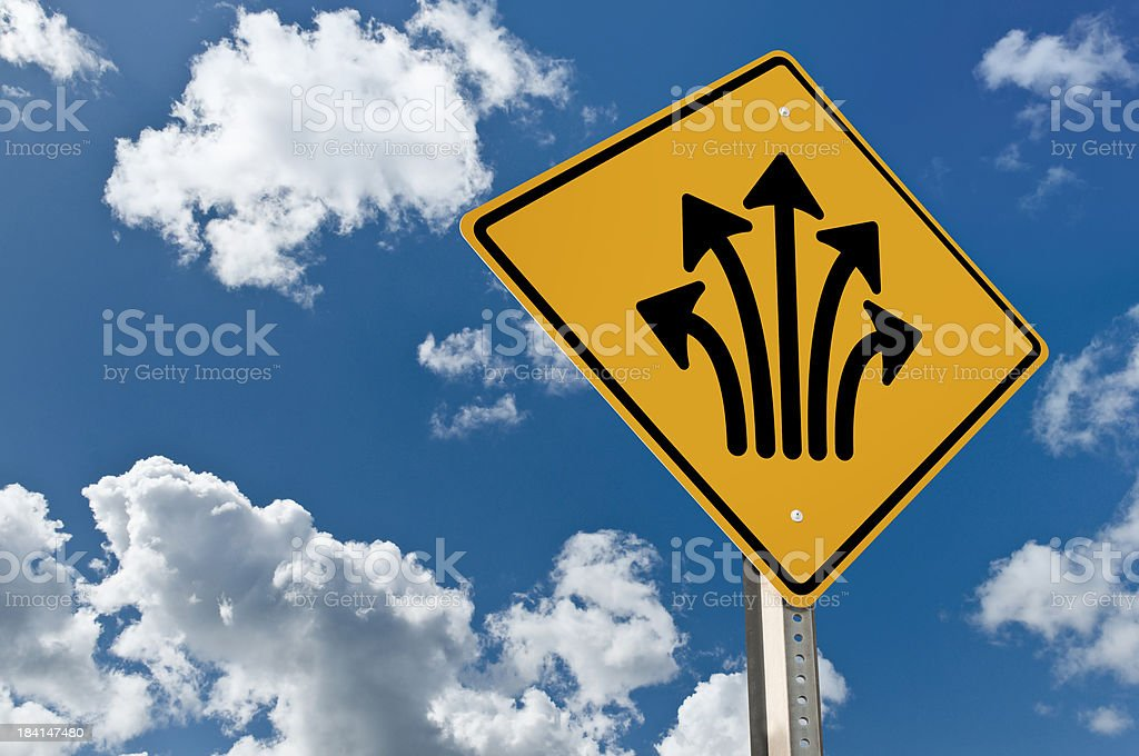 Yellow sign with multiple directions royalty-free stock photo
