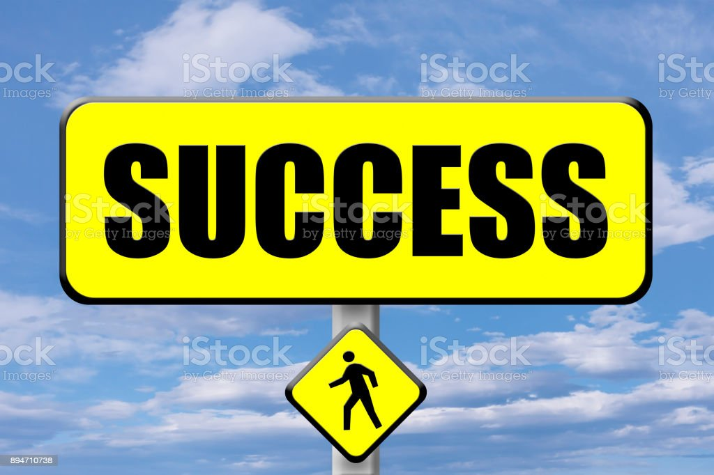 Yellow signboard with the word Success written stock photo