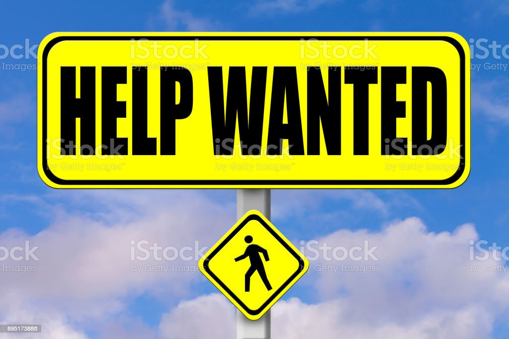 Yellow signboard with the words Help Wanted written stock photo