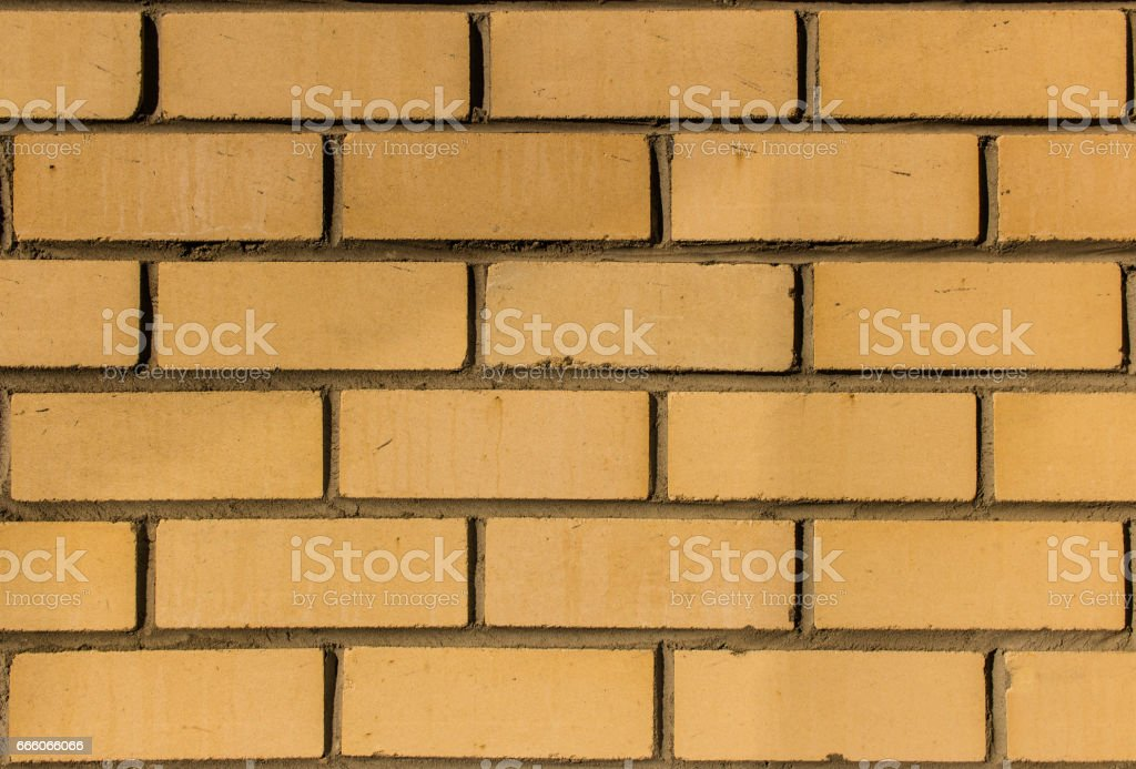 Yellow silicate brick wall closeup. stock photo