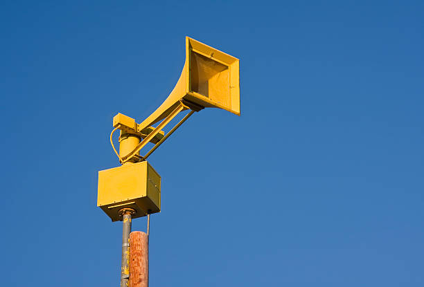 Yellow Siren Outdoor warning siren in western Nebraska. military attack stock pictures, royalty-free photos & images