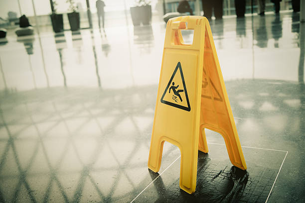 """Yellow slippery warning sign A yellow warning sign """"slippery """" slippery stock pictures, royalty-free photos & images"""