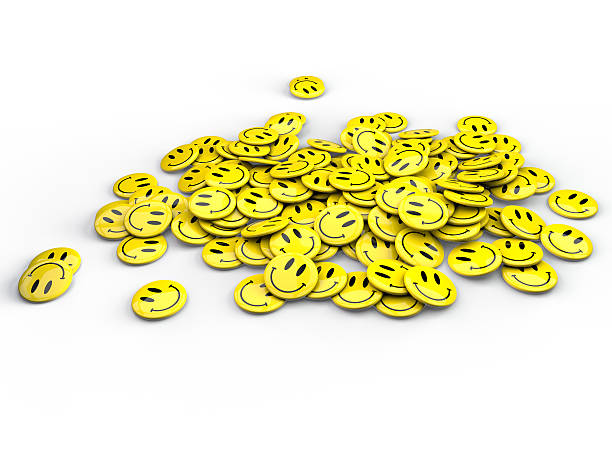 Yellow smiley face buttons on white background stock photo
