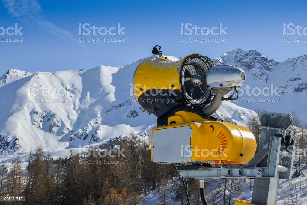 Yellow snow cannon snow maker machine, snow gun for production of snow on ski slopes stock photo