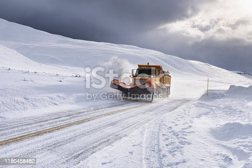 Snow plow in Yellowstone National Park during snowstorm.