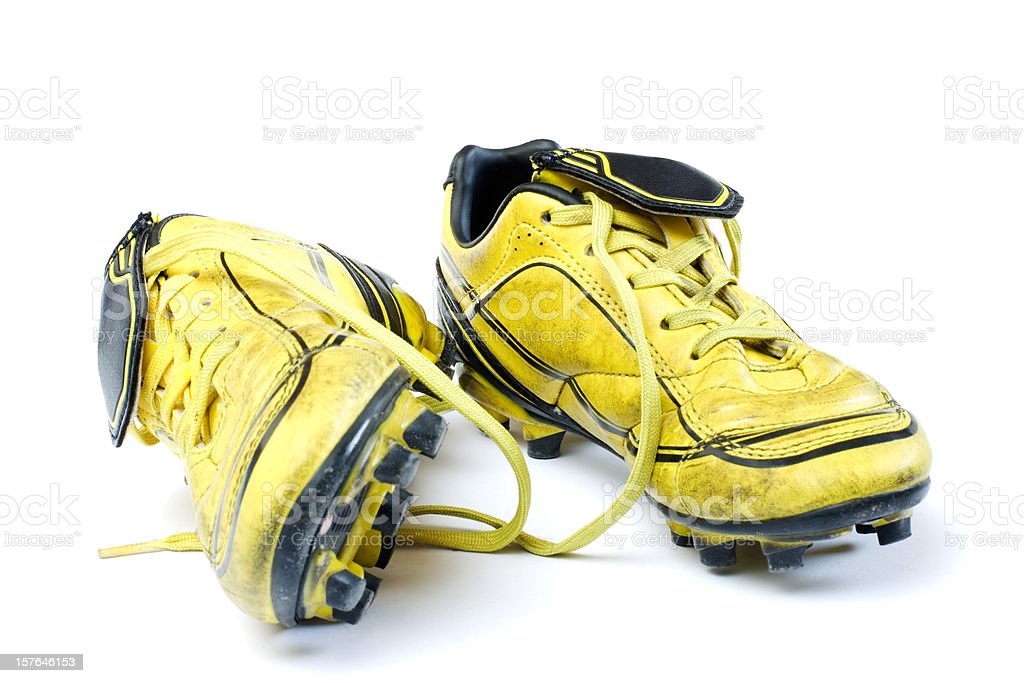 Yellow soccer cleats royalty-free stock photo
