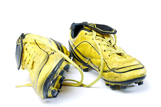 Yellow soccer cleats stock photo