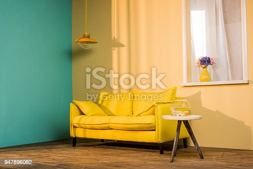 istock yellow sofa and aquarium on table in living room 947896082