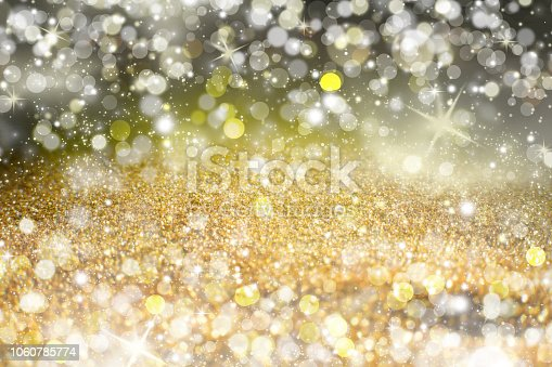 istock Yellow Sparkling Lights Festive background with texture. Abstract Christmas twinkled bright bokeh defocused and Falling stars 1060785774