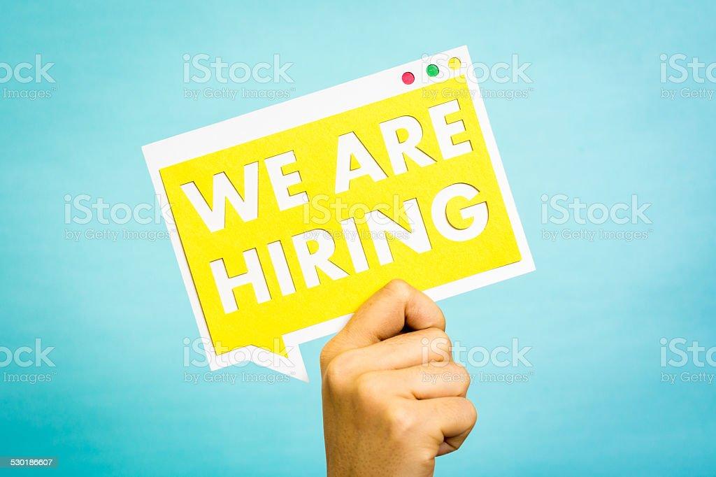 Yellow speech bubble job hiring message concept blue background stock photo
