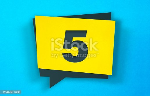 Yellow Speech Bubble Sticker On A Blue Background. Number 5. Horizontal composition with copy space