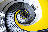 Epic downwards yellow staircase at a hospital in Lille Belgium.