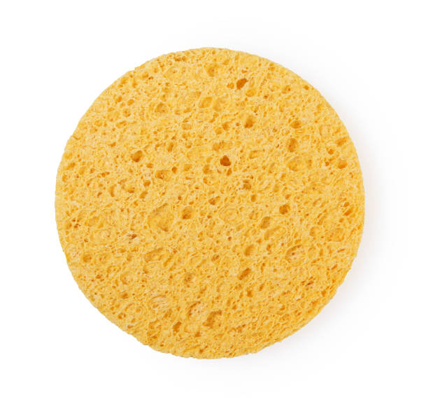 yellow sponge circle shape cleansing puff for face or cleaning - spugna per le pulizie foto e immagini stock