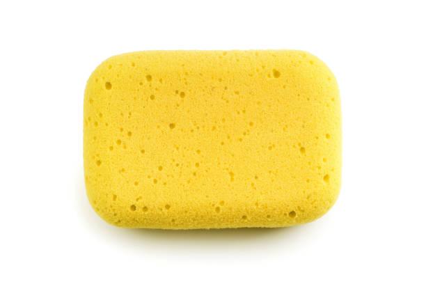 yellow sponge isolated on the white background - spugna per le pulizie foto e immagini stock