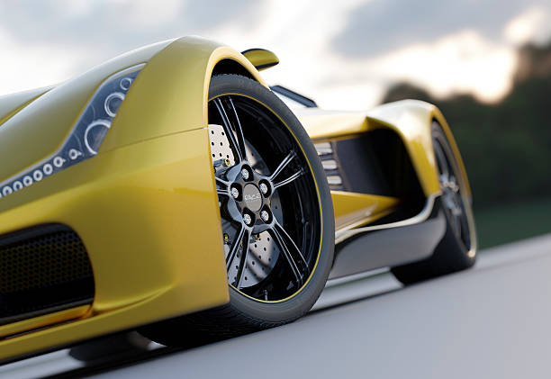 Yellow sport car from low view Close view of a golden sports car. Unique design, modelled entirely by myself. Very high resolution 3D render. All markings are fictitious. luxury car stock pictures, royalty-free photos & images
