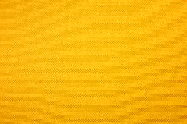 yellow sport jersey clothing texture - yellow stock photos and pictures