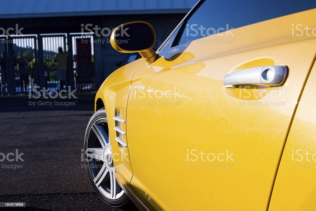 yellow sports car with allow wheel stock photo
