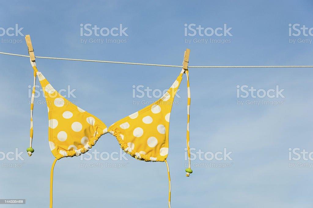 A yellow spotted bikini on a washing line royalty-free stock photo
