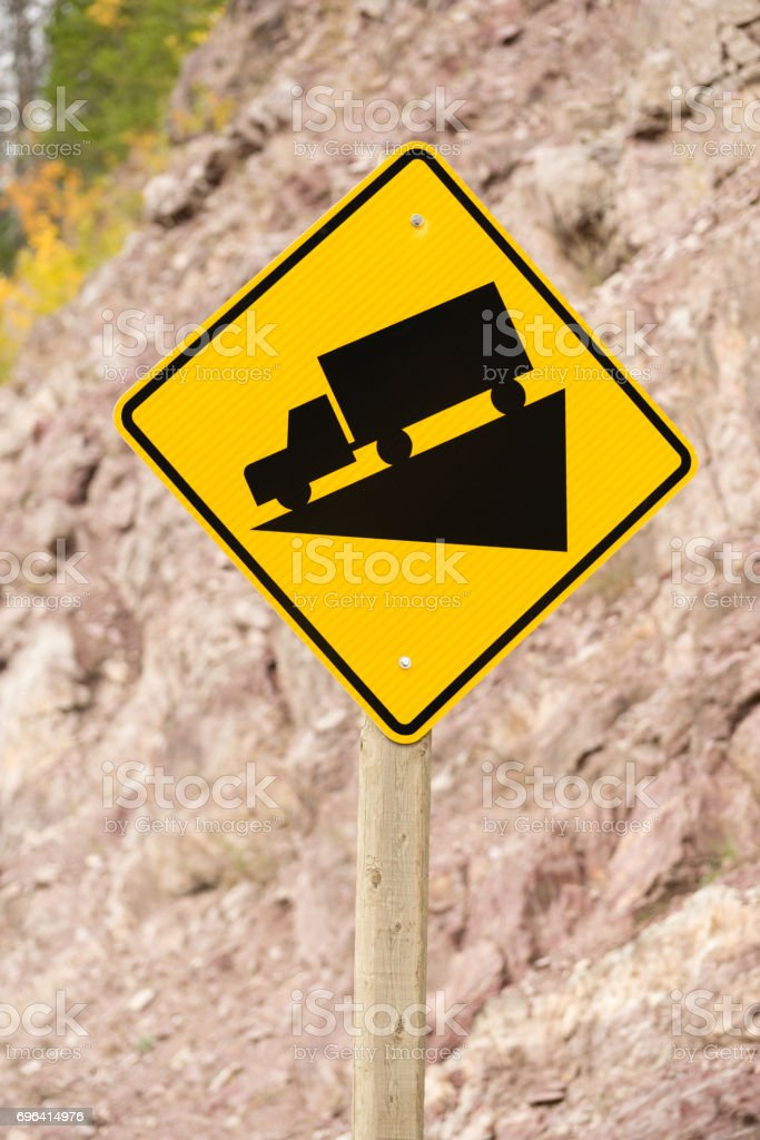 Yellow Square Road Sign Warning Steep Decline Ahead stock photo