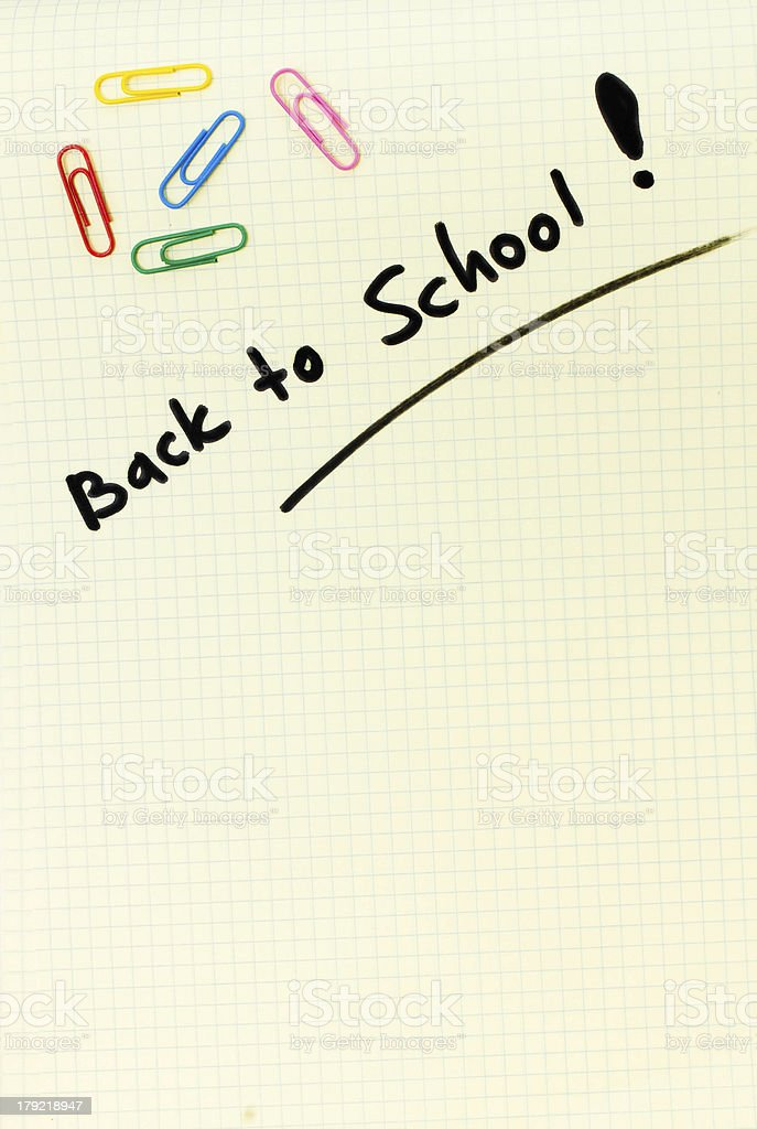 Yellow Squared notebook pencil white background back to school stock photo