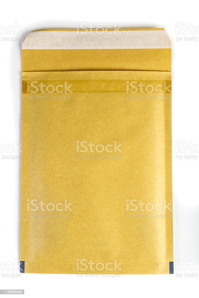 Yellow standard padded shipping envelope royalty-free stock photo