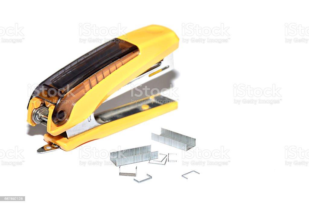 Yellow stapler on white background - fotografia de stock