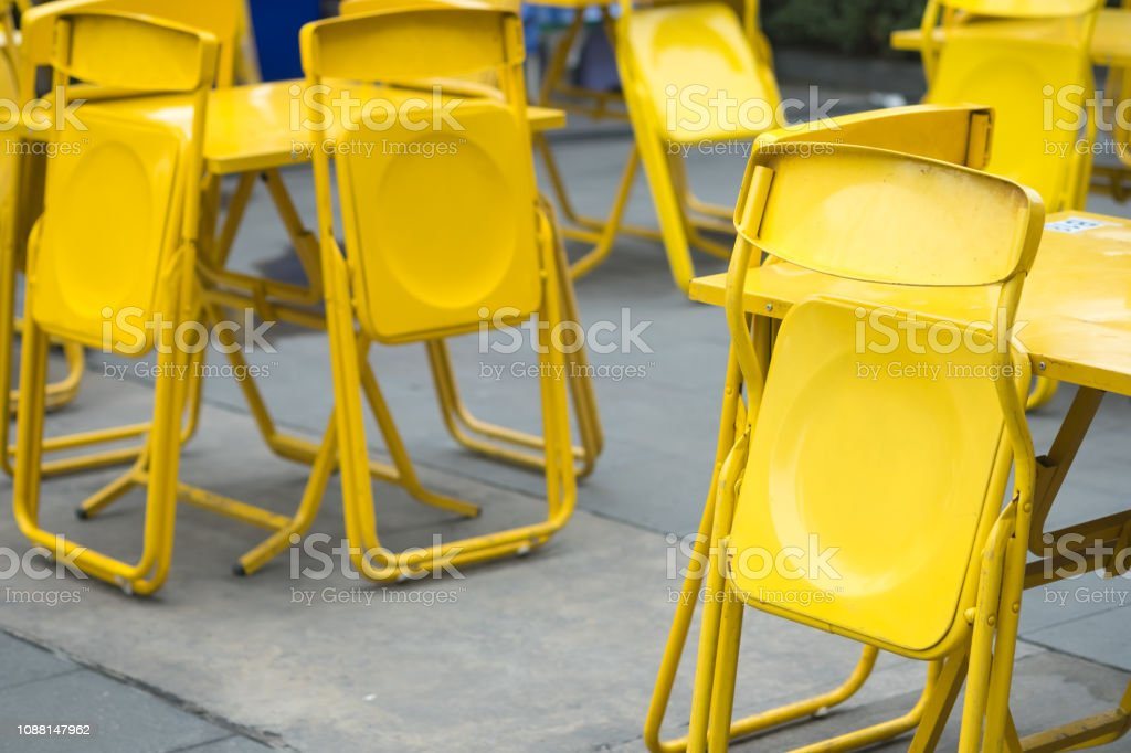 Yellow steel chair at outdoor restaurant prepare for open restaurant...