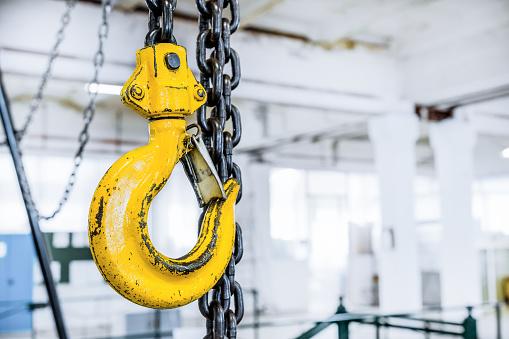 Yellow steel load-lifting hook