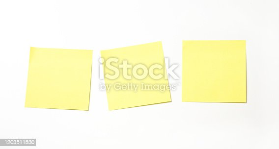 Yellow sticky note isolated on white background.