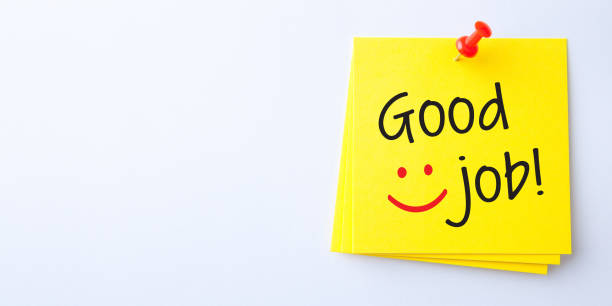 Yellow Sticky Note With Good Job And Red Push Pin On White Background stock photo