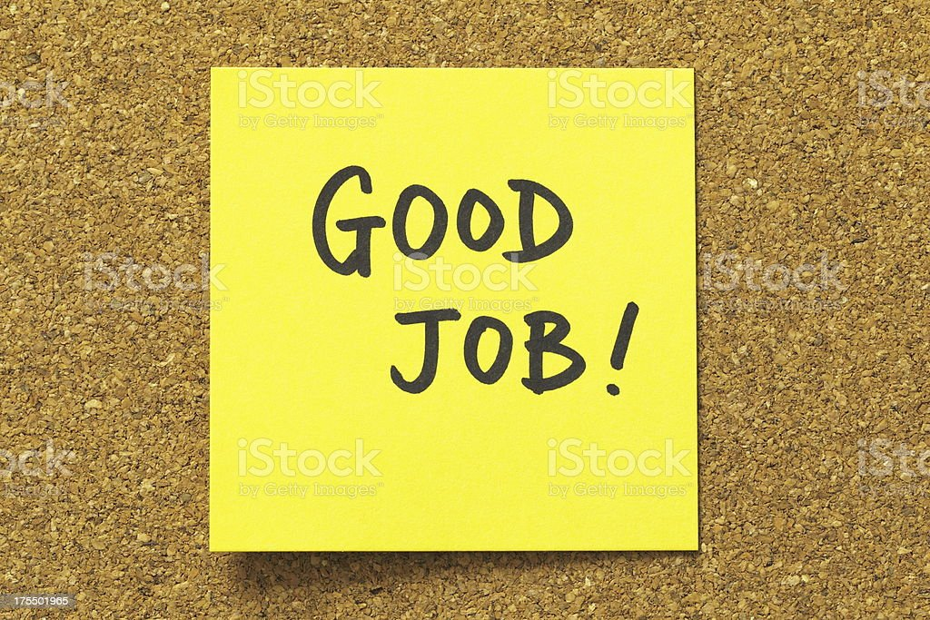 Yellow sticky note with good job in black marker royalty-free stock photo