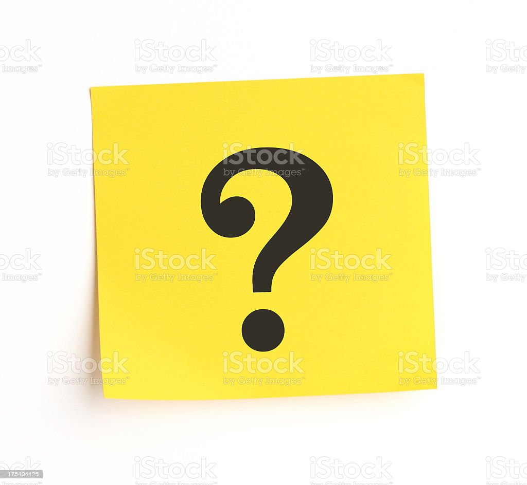 Yellow sticky note with question mark stuck on white wall stock photo