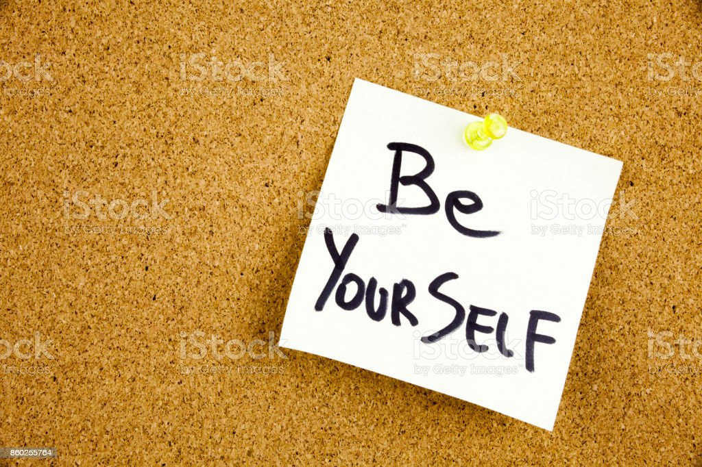 A yellow sticky note writing, caption, inscription Be your best self - positive words on a slate blackboard in black ext on a sticky note pinned to a cork notice board stock photo