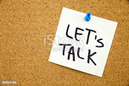 istock A yellow sticky note writing, caption, inscription Phrase LET'S TALK in black ext on a sticky note pinned to a cork notice board 859952496